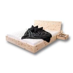 Zirbenholzbett mit 3D Wellenfräsung im Kopfteil. 2 Ablageflächen schwebend.