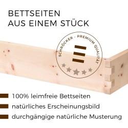 Am Bild sieht man zwei Bettseiten aus einem Stück mit einer gezinkten Holzverbindung (leimfrei)