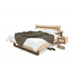 Zirbenholzbett mit Walnusseinlage im Kopfteil. Bügelfuss Walnut