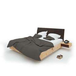 Zirbenbett mit lederüberzogenem Kopfteil. Nachtkästchenfront aus Leder. Schwebende Ausführung